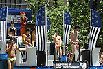 SEMI-NUDE GAY MEN on PLATFORM DURING GAY PRIDE PARADE<br />
