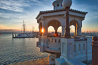 As we walked down the sea wall in Corpus Christi right as the sun was just coming up over the bay and began illuminating this lovely gazebo called the  Miradores Del Mar Gazebos which means overlook right in front of the marina. It was a perfect sunrise image with the gazebo and marina full of boats in the bay as the colors of morning sunrise lght up the area.