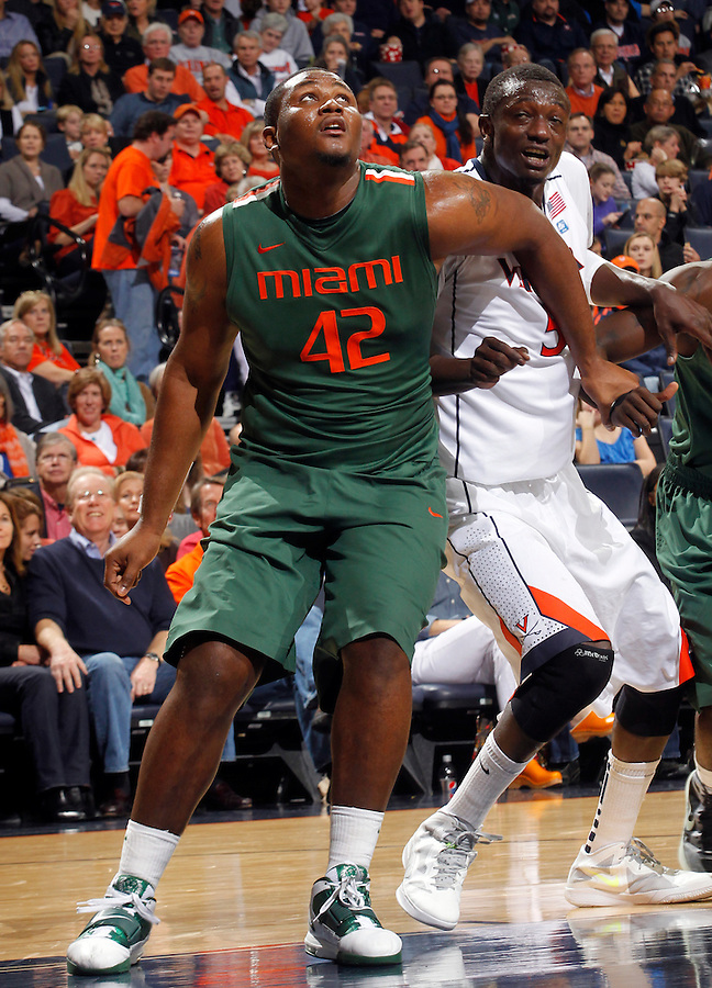 CHARLOTTESVILLE, VA- JANUARY 7: Reggie Johnson #42 of the Miami Hurricanes looks for the rebound with Assane Sene #5 of the Virginia Cavaliers during the game on January 7, 2012 at the John Paul Jones Arena in Charlottesville, Virginia. Virginia defeated Miami 52-51. (Photo by Andrew Shurtleff/Getty Images) *** Local Caption *** Assane Sene;Reggie Johnson