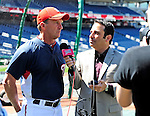 8 June 2010: Washington Nationals' Manager Jim Riggleman is interviewed by radio broadcaster Charlie Slowes prior to a game against the Pittsburgh Pirates at Nationals Park in Washington, DC. The Nationals defeated the Pirates 5-2 in the series opener where pitcher Stephen Strasburg made his Major League debut, pitching 7 innings, striking out 14 batters, while notching his first win in the majors. Mandatory Credit: Ed Wolfstein Photo
