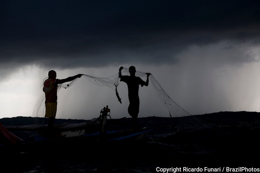 Fishing in a jangada - seaworth sailing raft used by fishermen of northeastern Brazil – storm in ocean. Rio Grande do Norte State, Brazil.