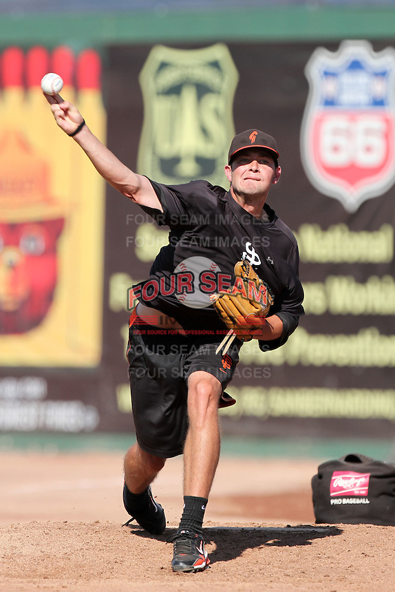 San Jose Giants pitcher Chris Heston #33 pitches in the bullpen before a game against the Inland Empire 66'ers at Arrowhead Credit Union Park on August 1, 2011 in San Bernardino,California. San Jose defeated Inland Empire 2-1.(Larry Goren/Four Seam Images)