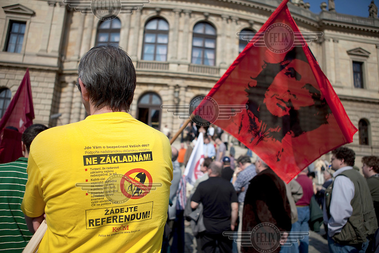 A member of the Communist Party of the Czech Republic (KSCM) holds a flag of Che Guevara as he demonstrates against a planned US military radar base in the Czech Republic, on the day of President Barack Obama's visit to Prague.