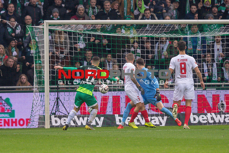 10.02.2019, Weser Stadion, Bremen, GER, 1.FBL, Werder Bremen vs FC Augsburg, <br /> <br /> DFL REGULATIONS PROHIBIT ANY USE OF PHOTOGRAPHS AS IMAGE SEQUENCES AND/OR QUASI-VIDEO.<br /> <br />  im Bild<br /> <br /> 1:0 Milot Rashica (Werder Bremen #11) gegen Gregor Kobel (FC Augsburg #40)<br /> Konstantinos Stafylidis (FC Augsburg #03)<br /> Rani Khedira (FC Augsburg #08)<br /> Foto &copy; nordphoto / Kokenge