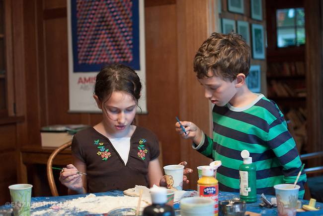 Berkeley CA, Siblings, 6 & 8, working together on art project at home  MR