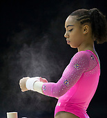 22nd March 2018, Arena Birmingham, Birmingham, England; Gymnastics World Cup, day two, womens competition; Margzetta Frazier (USA) taping her wrists before warming up on the Uneven Bars before the competition