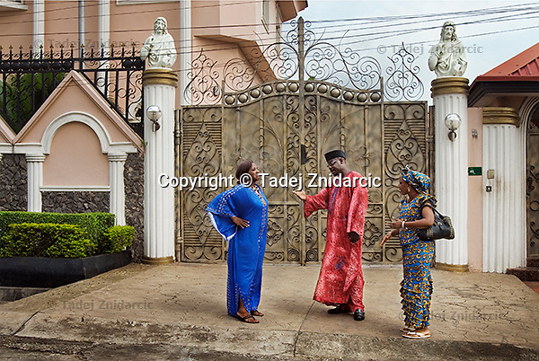Actors Adaobi Enekwa, Richard Dike and Ngozi Doomanbey (left to right) play members of high society in a scene of a Nollywood movie production. Homes in richer neighborhoods of Lagos are often used for the setting of these movies.