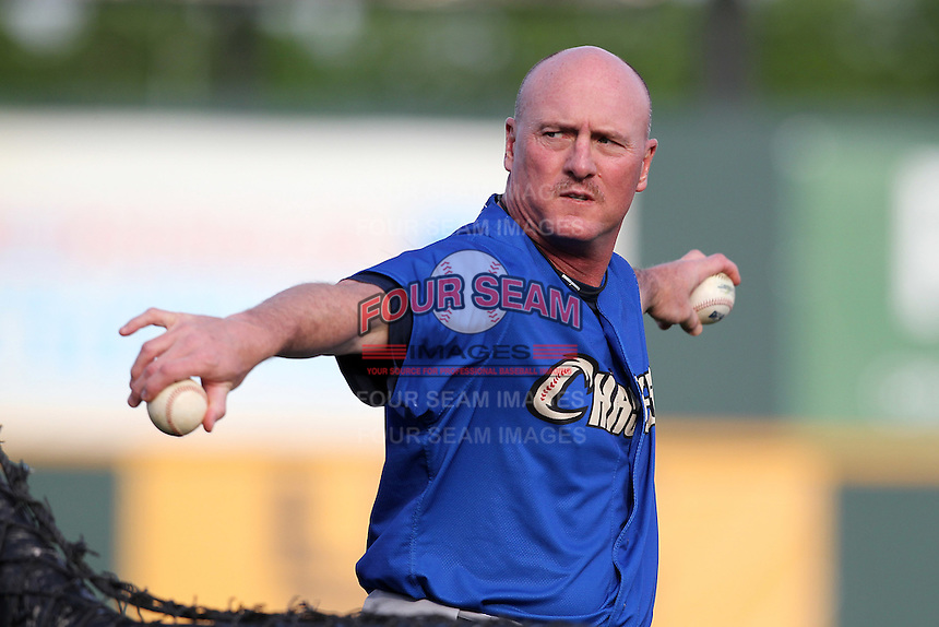 Omaha Storm Chasers coach Tommy Gregg #11 throws a pitch during batting practice before a game against the Nashville Sounds at Greer Stadium on April 25, 2011 in Nashville, Tennessee.  Omaha defeated Nashville 2-1.  Photo By Mike Janes/Four Seam Images