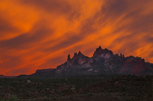 A fiery sunset lights up the sky at Eagle Crags just outside Zion National Park Utah