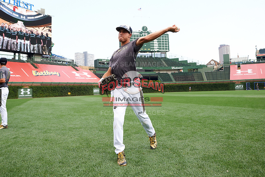Dylan Carlson (6) of Elk Grove High School in Elk Grove, California warms up during practice before the Under Armour All-American Game on August 15, 2015 at Wrigley Field in Chicago, Illinois. (Mike Janes/Four Seam Images)