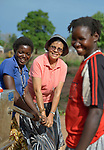 Sister Raquel Peralta (center), a Catholic nun from Paraguay, helps women pump water from a well in a camp for more than 5,000 displaced people in Riimenze, in South Sudan's Gbudwe State, what was formerly Western Equatoria. Families here were displaced at the beginning of 2017 as fighting between government soldiers and rebels escalated.<br /> <br /> Peralta is a member of the Missionary Sisters Servants of the Holy Spirit, and works in South Sudan as part of Solidarity with South Sudan, an international network of Catholic groups working in the newly independent country. Solidarity and Caritas Austria have both supported efforts by the diocese to ensure that the displaced families here have food, shelter and water.