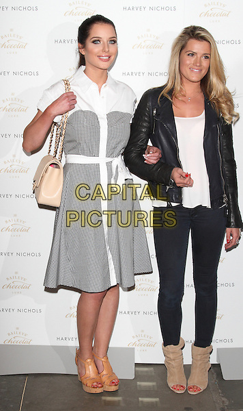 LONDON, ENGLAND - APRIL 15: Helen Flanagan and Karis Kennedy attend the VIP launch of Baileys Chocolat Luxe's immersive theatre event Baileys Feaster Egg Hunt on April 15, 2014 in Harvey Nichols, London, England<br /> CAP/ROS<br /> &copy;Steve Ross/Capital Pictures