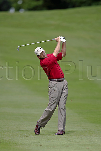 25 May 2006: South African golfer Retief Goosen (RSA) plays his approach shot from the 4th fairway during the first round of the BMW Championship, played on the West Course at Wentworth. Photo: Glyn Kirk/Actionplus...060525 golf man male