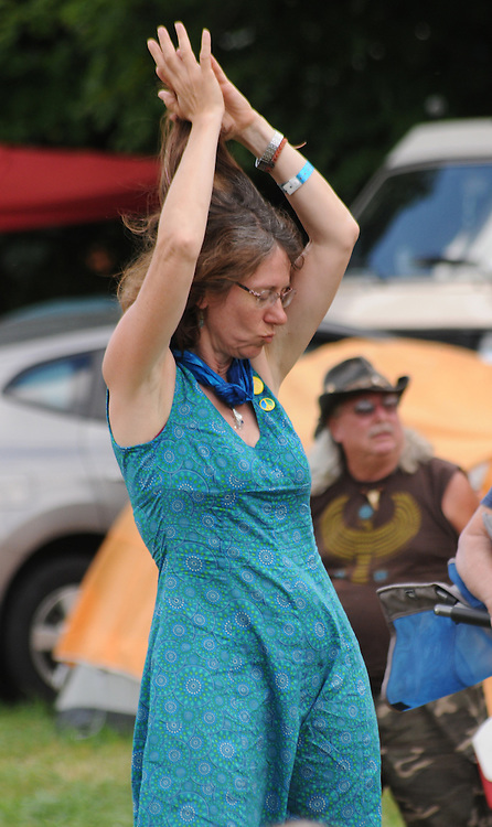 """Members of the audience listening to the """"Our Roots Are Showing"""" Show at the Workshop Stage at the Falcon Ridge Folk Festival, held on Dodd's Farm in Hillsdale, NY on Saturday, August 1, 2015. Photo by Jim Peppler. Copyright Jim Peppler 2015."""