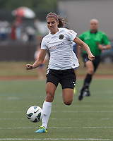 Portland Thorns FC forward Alex Morgan (13) collects a pass to the start of a scoring effort. In a National Women's Soccer League (NWSL) match, Portland Thorns FC (white/black) defeated Boston Breakers (blue), 2-1, at Dilboy Stadium on July 21, 2013.