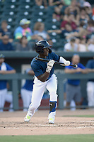 Right fielder Gerson Molina (12) of the Columbia Fireflies bats in a game against the Augusta GreenJackets on Saturday, June 1, 2019, at Segra Park in Columbia, South Carolina. Columbia won, 3-2. (Tom Priddy/Four Seam Images)