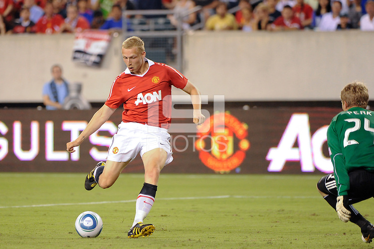 Ritchie De Laet (30) of Manchester United takes a shot as Philadelphia Union goalkeeper Brian Perk (24) defends. Manchester United (EPL) defeated the Philadelphia Union (MLS) 1-0 during an international friendly at Lincoln Financial Field in Philadelphia, PA, on July 21, 2010.