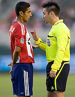 CD Chivas USA defender Mariano Trujillo (8) being scolded by referee Edvin Jurisevic. The Philadelphia Union and CD Chivas USA played to 1-1 draw at Home Depot Center stadium in Carson, California on Saturday evening July 3, 2010..