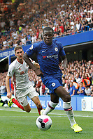 Kurt Zouma of Chelsea is closed down by Chris Basham of Sheffield United during the Premier League match between Chelsea and Sheff United at Stamford Bridge, London, England on 31 August 2019. Photo by Carlton Myrie / PRiME Media Images.