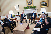 United States President Barack Obama and US Vice President Joe Biden hold a meeting with select Cabinet Secretaries of the Council on Women and Girls in the Oval Office in Washington, District of Columbia, U.S., on Wednesday, January 22, 2014.<br /> Credit: Pete Marovich / Pool via CNP