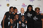 Skaters pose with Scott Hamilton who is honored tonight - Figure Skating in Harlem celebrates 20 years - Champions in Life benefit Gala on May 2, 2017 in New York Ciry, New York.   (Photo by Sue Coflin/Max Photos)