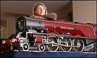 BNPS.co.uk (01202) 558833<br /> Picture: Laura Jones<br /> <br /> Chuffed...<br /> <br /> The model train world is getting steamed up over a superb collection of immaculate 7 1/4 guage locos being sold at Dreweatts auctioneers near Newbury.<br /> <br /> Tessa Parry from Dreweatts with 'Duchess of Abercorn' valued at &pound;50,000<br /> <br /> A train enthusiast's stunning collection of model steam engines he used to happily drive around his garden is tipped to sell for over &pound;200,000. <br /> <br /> With the help of his family the late Don Witheridge from Norfolk laid three-quarters of a mile of track on his five acres of land he bought from British Rail and commissioned prominent locomotive builders to make model steam engines. <br /> <br /> The locos are exact working replicas of real engines from the golden age of steam