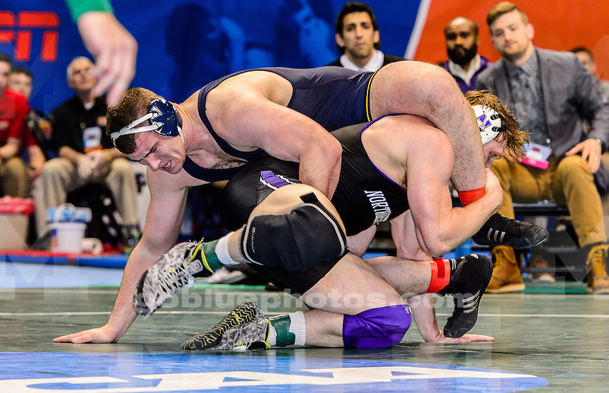 Michigan wrestlers compete on day 2 at the 2015 NCAA Wrestling Championships at the Scottrade Center, St Louis, MO, March 20, 2015.