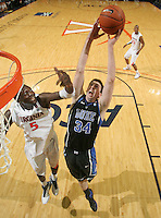 Feb. 16, 2011; Charlottesville, VA, USA; Duke Blue Devils forward Ryan Kelly (34) grabs the rebound in front of Virginia Cavaliers center Assane Sene (5) during the first half of the game at the John Paul Jones Arena.  Credit Image: © Andrew Shurtleff