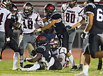 Lawndale, CA 09/29/17 - Jordan Wilmore (Lawndale #1) and unidentified Torrance player(s) in action during the Torrance vs Lawndale CIF Varsity football game at Lawndale High School.   Lawndale defeated Torrance 42-0.