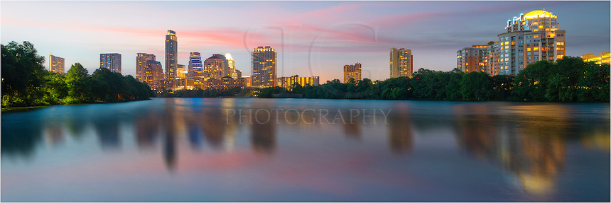 Late in the evening, the Austin skyline shines over the waters of Ladybird Lake. This long exposure captured the scene of downtown Austin from the newly constructed boardwalk that runs along the south shore between Congress Bridge and I-35. In this panorama, buildings such as the 360 Condos, the Austonian, and the iconic Frost Tower can be seen.