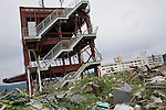 Photo shows the  Crisis Management Center in Minamisanriku Town, Miyagi Prefecture, Japan, shortly after the 11 March 2011 disasters. While the municipal hospital (which can be seen in this photograph to the right of the disaster prevention center) and other damaged structures in the town have recently been dismantled, the disaster prevention headquarters remains as residents and leading community figures debate the value of leaving the structure standing as a monument. Photographer: Rob Gilhooly