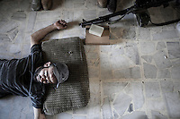 ALI, the sniper of a rebel fighters group belonging to the Liwa Al Tawhid takes a rest at the rebel post in Zahoor before move to the fighting at the Saif Al Dawla battlefield in southwest of Aleppo City. During last days the first line of fighting have moved into Saif Al Dawla residential neighborhood for the control of the area.