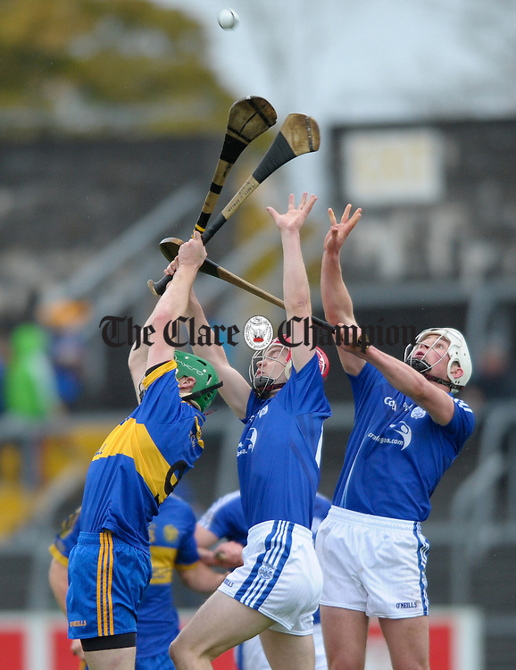 Martin O Hanlon of Newmarket On Fergus in action against Sean Chaplin and Damien Browne of Cratloe during the senior county hurling final at Cusack Park. Photograph by John Kelly.
