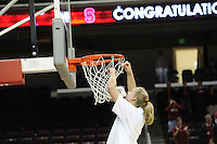 March 14, 2010. Mikaela Ruef cuts down the net after the Stanford Cardinal beat the UCLA Bruins to win the 2010 Pac-10 Tournament.