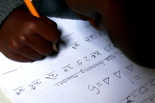 A student concentrates on numerical sequences at the Early Childhood Development school at Pepo La Tumaini Jangwani, a community based HIV/AIDS program in Isiolo, Kenya., on Tuesday, July  29, 2008.  (Photo by Bryce Yukio Adolphson, © 2008)