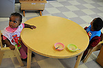 Cameryn Jointer and Eddie Washington, both 11 months old, at the Educare Early Childhood Center in Chicago on November 21, 2008.  The pre-K daycare center is a model for head start, funded privately by the Gates and other foundations, that cares for and educates infants, toddlers, and 3- and 4-year old pre-school children.