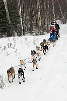 Sebastian Schnuelle w/Iditarider on Trail 2005 Iditarod Ceremonial Start near Campbell Airstrip Alaska SC