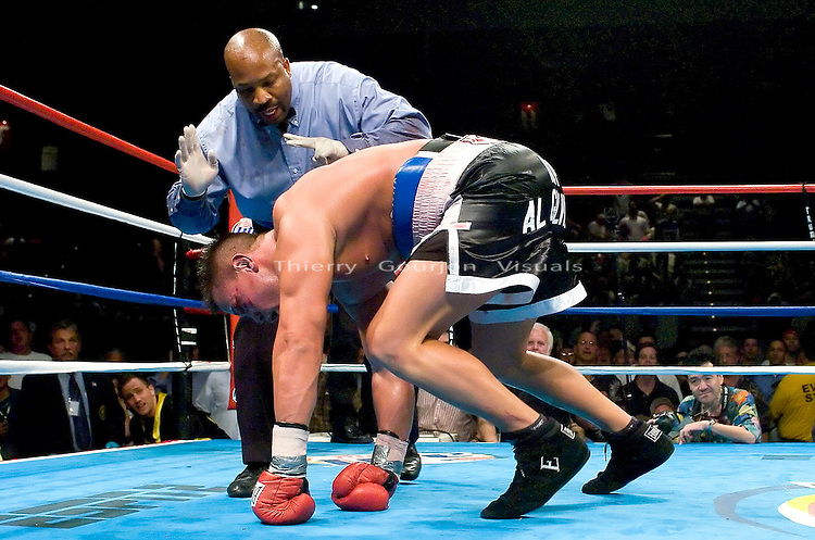 Vinny Maddalone tries to get up after being knocked down by  Brian Minto during their 10 rounds Heavyweight fight at the Taj Mahal Casino in Atlantic City, NJ on  07.23.04. Minto won by KO in the 10th round