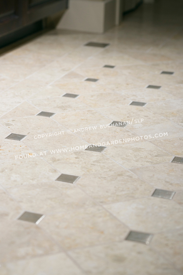 A shallow focus, close up deatil shot of a repeating pattern of floor tiles in this bathroom BA in a contemporary home.