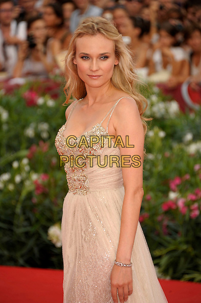 Diane Kruger (wearing Elie Saab).'The Ides of March' screening.68th Venice International Film Festival, Italy 31st August 2011.half length embellished bodice nude side tulle dress gown sheer beige gold .CAP/PL.©Phil Loftus/Capital Pictures.