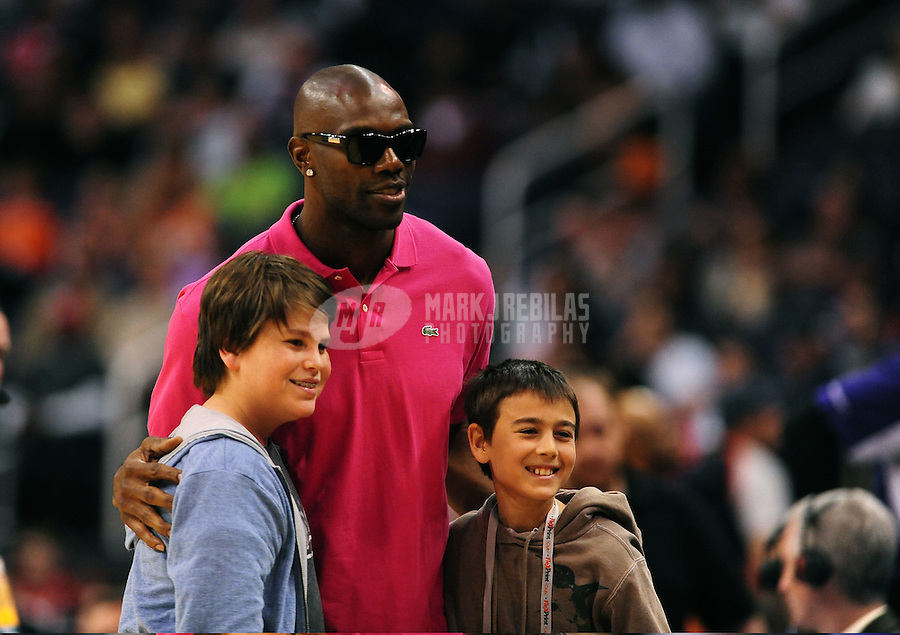 Mar. 2, 2012; Phoenix, AZ, USA; Football player Terrell Owens poses for a photo with young fans the game between the Phoenix Suns against the Los Angeles Clippers at the US Airways Center. The Suns defeated the Clippers 81-78. Mandatory Credit: Mark J. Rebilas-USA TODAY Sports