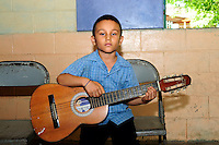 Young student of the Music for Hope youth project, based in the community of Nueva Esperanza , El Salvador.