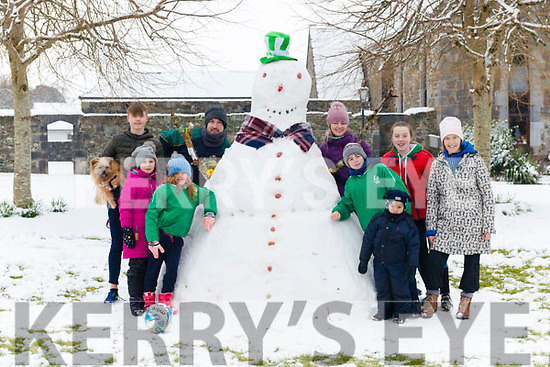 l-r Kate Fleming, Elizabeth Fabian, Darragh and Timmy Flemming, Aidan Fabian, Oisinn, Majella and Becci Fleming and Lilly Fabian all from Killarney joined the forces to make the giant snowman at The Old Monastery last Friday.