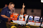 Rogers' Gary Phair signals to fans and teammates as he is taken off the field on a stretcher by paramedics after suffering an injury against Fort Smith Northside.
