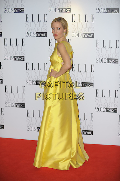 Gillian Anderson.'Elle Style Awards 2012' at The savoy Hotel, London, England..13th February 2012.full length yellow silk satin sleeveless dress hand on hip side .CAP/CAS.©Bob Cass/Capital Pictures.