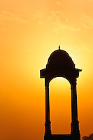 Tower near the India Gate silhouetted at sunset, New Delhi, India