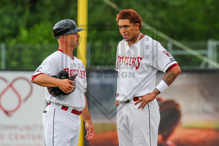 Wisconsin Timber Rattlers manager Matt Erickson (8) and shortstop Gilbert Lara (11) during a Midwest League game against the Quad Cities River Bandits on June 8, 2017 at Fox Cities Stadium in Appleton, Wisconsin.  Wisconsin defeated Quad Cities 8-3. (Brad Krause/Krause Sports Photography)