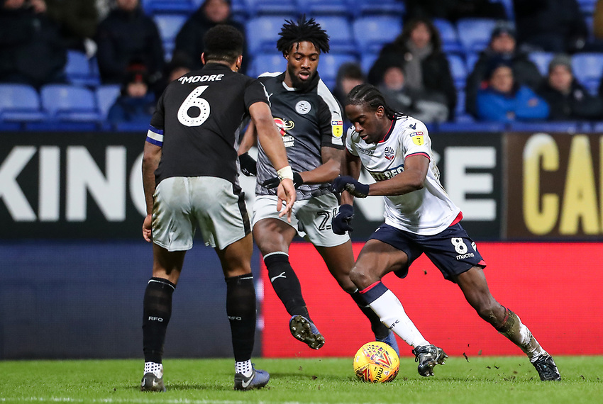 Bolton Wanderers' Clayton Donaldson competing with Reading's Tyler Blackett and Liam Moore<br /> <br /> Photographer Andrew Kearns/CameraSport<br /> <br /> The EFL Sky Bet Championship - Bolton Wanderers v Reading - Tuesday 29th January 2019 - University of Bolton Stadium - Bolton<br /> <br /> World Copyright © 2019 CameraSport. All rights reserved. 43 Linden Ave. Countesthorpe. Leicester. England. LE8 5PG - Tel: +44 (0) 116 277 4147 - admin@camerasport.com - www.camerasport.com