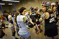 Shellby Shattered (left) compares tattoos with an opponent, before a roller derby bout in Wilmington, Massachusetts. Roller derby is an American contact sport, popular with young women, which combines both athleticism and a satirical punk third-wave feminism aesthetic.