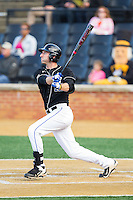 Aaron Cohn (12) of the Duke Blue Devils follows through on his swing against the Wake Forest Demon Deacons at Wake Forest Baseball Park on April 25, 2014 in Winston-Salem, North Carolina.  The Blue Devils defeated the Demon Deacons 5-2.  (Brian Westerholt/Four Seam Images)